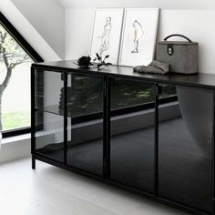 The Anders Sideboard by Ethnicraft is a fresh twist on traditional cabinetry. The solid black frame contrasts with a glass surface. Living Room Storage, Storage Spaces, Desk Storage, Solid Wood Furniture, Furniture Design, Wood Sofa, Bathroom Furniture, Adjustable Shelving, Interiores Design