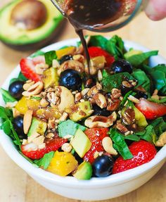 Strawberry Spinach Salad, with Blueberries, Mango, Avocado, and Cashew nuts, with a Balsamic Vinaigrette salad dressing.