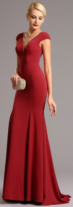 Red gown with stylish illusion v cut and capped sleeves!