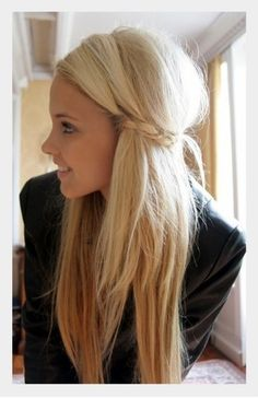Braid the pieces of hair right in front of your ears, then secure them at the back to keep the rest of your hair out of your face. CUTE!