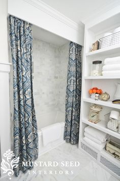 Miss Mustard Seed's Master Bathroom - I love the wood/crown molding hiding the shower curtain rod. The curtain is pretty, too!