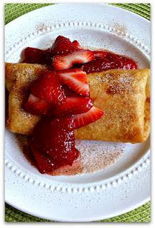 "Cheesecake Burrito  Ingredients:  1 8 oz block of cream cheese, softened  4 Tbsp powdered sugar  1 tsp vanilla  1/2 tsp cinnamon (especially good if you decide to go with the apple topping)  4 flour tortillas (soft taco size, 6 or 8"")  1 pt strawberries, washed and sliced  1/4 cup granulated sugar  2 to 4 cups canola oil, for frying"