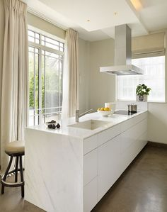 Kitchen Architecture - Home - Luxury apartment   - Carrera marble countertop & sink.