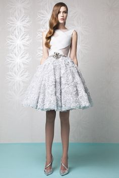 Short princess Silver dress with a Silk Crepe cutout bust, embellished with Lace appliques and a belt accessory on the skirt.