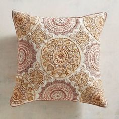 Here is the perfect example of when a pillow goes from pretty to a work of art. Our beautiful pillow features intricately embroidered medallions in soft golden and blush shades.