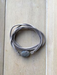 Gray suede wrap bracelet with gray natural stone bead connector