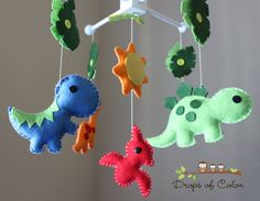 Baby Crib Mobile  Baby Mobile  Dinosaur Mobile by dropsofcolorshop, $90.00; Chris LOVES this one too