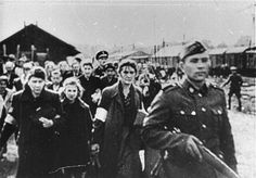 """A scene from the film """"Between Vistula and Rhine"""" showing the deportation of Jews from an unidentified ghetto by the SS.  1940-1943. Poland World War Two"""