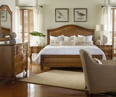 Light brown woods with a white and neutral color scheme make this bedroom reminiscent of a sandy beach.