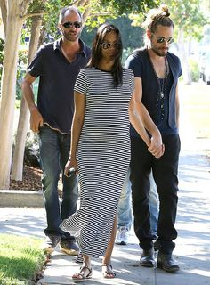 Proudly bumping: Zoe Saldana showed off her growing belly as she stepped out with her husband Marco Perego in Los Angeles, California on Sunday