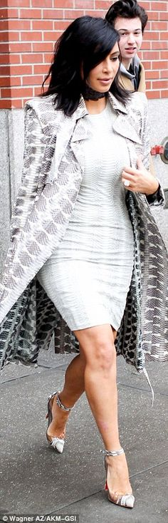 Theme dressing: The 34-year-old wore head-to-toe grey snakeskin print as she headed out to an event