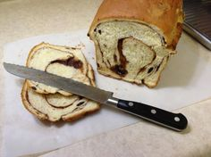 """""""World's Best Cinnamon Raisin Bread"""" just came out of the oven, so I can't confirm if it's the best or not yet!"""