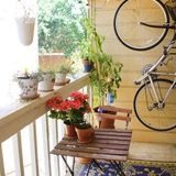 One of our favorite house tours in recent memory is the Austin home of cute couple Jenny and Collin, who, despite living in one of those beige, cookie-cutter apartment complexes managed to create a bold, colorful and personality-filled home. To say we were surprised to learn their miniscule outdoor areas were given equally thoughtful design treatment would be a lie; we knew they'd be adorable.