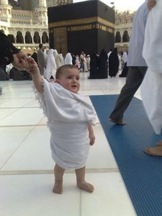 Baby boy visits Mecca for Hajj . <3 wonder if we will take our children one day??