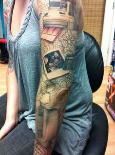 photo sleeve tattoo. holy crap that is awesome.