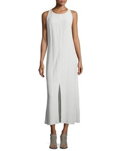 Eileen Fisher dress in crinkle-crepe. Round neckline; button closure with keyhole at back. Sleeveless; moderate shoulder coverage. Slim silhouette. Front center slit. Straight hem. Pullover style. Ten