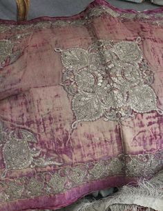 This beautifully worn 18th century magenta silk velvet panel is heavily embroidered with a cool to the touch stylized silver frieze border of palm leaves decorated with foliage and rosettes. The 18th c portraits of Jean-Etienne Liotard capture the passion that 18th France had for Turqurie (Turkish fashion). Arriving in Paris from the exotic far off lands of the Ottoman Empire, the panels original usage was either as a table tapestry or Caparaçon dapparat, a ceremonial cover (saddlecloth)…