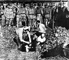 Chinese to be buried alive by Japanese soldiers during Nanking Massacre. In another photo which presents the same scene was discovered in Japan, verifying its authenticity.