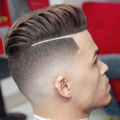 slicked back undercut, man seen from a back angle, close up on head, brown hair shaven on sides and long swept back on top