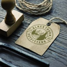 Create a vintage woodsman logo for Blackthorn Outfitters by CBT