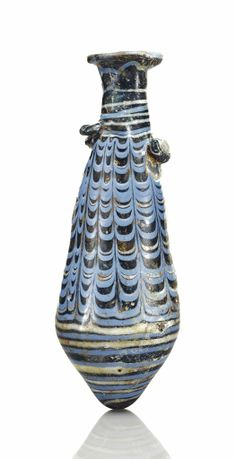 An Eastern Mediterranean blue glass alabastron Circa Mid 2nd-early 1st century B.C.