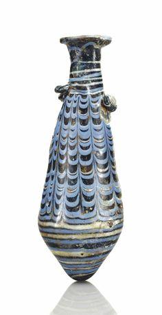 An Eastern Mediterranean blue glass alabastron Circa Mid 2nd-early 1st century B.C.
