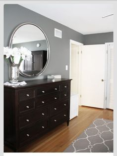 Grey bedroom with black furniture and silver