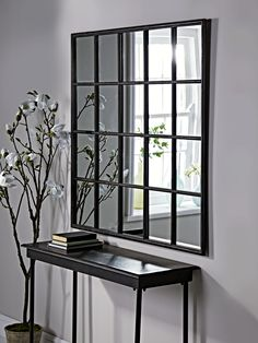 With a gently distressed black iron finish and twenty mirrored panels, our bold industrial style window mirror will make a statement in your living space. Inspired by our bestselling window mirror collection, it encapsulates factory chic with an elegant twist.