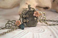 Fairy Door Wish Locket, Hobbit Door Necklace, Celtic Knot Leaves and Flowers Necklace. $26.00, via Etsy.