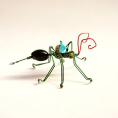 green ant wire sculpture made of aluminium and natural seeds