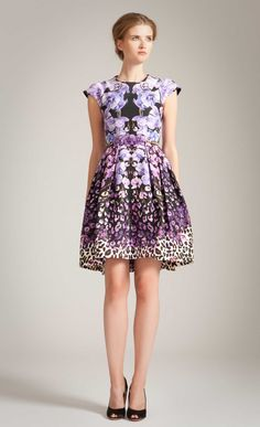 The Temperley London Orchidea Structured Dress, from the Spring Summer 2014 collection, blends contemporary styling with feminine prints. In a cotton silk fabric, this dress features a mirrored in-house designed print of leopard and orchid patterns, together with flattering seaming and a pleated skirt to accentuate the waist. A capped sleeve style, it is finished with luxurious silk lining and a back zip fastening.  Fabric composition: 75% cotton 25% silk, lining 100% silkTrue to sizeModel…