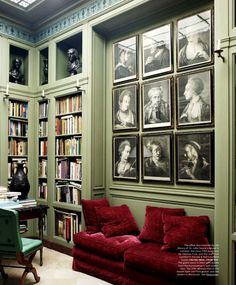 Traditional Library with medium Jade Green walls and Garnet red couch.