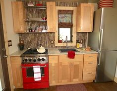 """David Cottrell and his wife Kristen Moeller have rebuilt their home following the Lower North Fork Fire in 2012 featured in Tiny House Nation with 24"""" BlueStar Range in RAL 3001"""