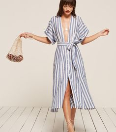 """If it doesn't feel like Summer yet, throw on Reformation's Geneva dress ($218) — the lightweight linen and blue and white stripes should do the trick!"" — HWM"