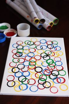 Easy Olympic Craft for Kids - kids can stamp up a piece of Olympic Ring Art to hang in the playroom or the classroom in honour of the Summer or Winter Olympic games - Happy Hooligans olympic games Olympic Ring Art for Preschoolers Kids Olympics, Summer Olympics, Special Olympics, Tokyo Olympics, Summer Art Projects, Projects For Kids, Happy Hooligans, Olympic Games For Kids, Olympic Crafts