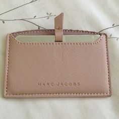 NWOT MARC JACOBS Mirror with Case New, without tags. Silver plate mirror with a nude colored leather case. Mirror has a leather pull tab to make it easy to remove from its case. Protective seal is still on both sides of the mirror. Marc Jacobs Accessories