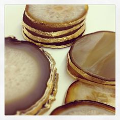 Natural Agate Coasters with Gold Leaf Edge, http://www.highstreetmarket.com/collections/home-decor/products/set-of-4-natural-agate-coasters-with-gold-leaf-edge