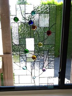 Glass beads in window for Linda