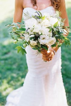 Loose, Romantic Peony Bouquet with Greenery. Brittanie's Italian-inspired vineyard wedding in Napa Valley was filled with tons of fresh and natural details like her loose bouquet of wild greens, lavender, and white peonies, arranged by Spiral Hand Design.