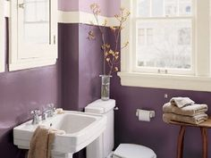 How to Incorporate Purple Bathroom Accessories.  This room is a cute combination of purple bathroom accessories and purple paint giving this bathroom a heavenly feel.
