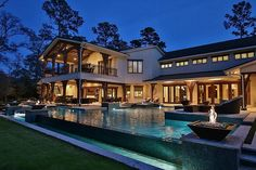 55 Silver Iris Way The Woodlands, TX 77382: Photo Spectacular Infinity edge pool has multiple fire and  waterfall features. 60,000 gallon. 10 ft. deep. LED lighting with color command. Jandy Aqua-Link remote.
