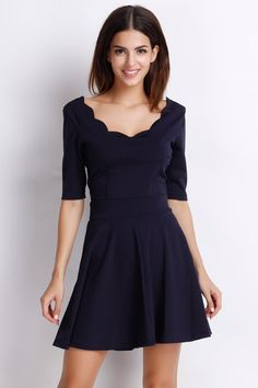 Essential Black Half Sleeve A-Line Dress with Scalloped Hem. Make some waves on dry land this fall. The Dress is made in medium, and has a scalloped round neck, 1/2 sleeves,flounced hem. It has a flirty a line silhouette, and the dress will keep you warme