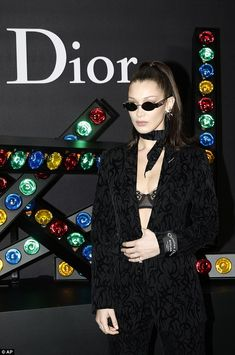 Power dressing: The runway star put on a very sexy display as she donned a Christian Dior suit to best showcase her model-honed figure