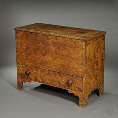 Diminutive Putty-painted Pine Chest over Drawer, possibly Maine, c. 1830-40, the lift top opens to a well, with drawer below, on bracket base and cutout sides, original putty-painted surface of