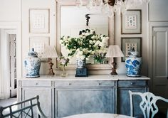 Stunning sideboard via Lonny. Love the blue and white ginger jars.