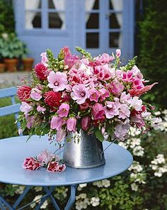 A galvanized bucket OVERFLOWING with fresh cut PINK BEAUTIES from the backyard flower faerie garden!! SOON!! <3