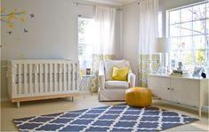 oeuf crib, yellow pouf, and overstock rug