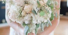 Blush bridal bouquet featuring pink and ivory toned hydrangeas, spray roses, peonies, vendella roses, dusty Miller, and seeded eucalyptus.