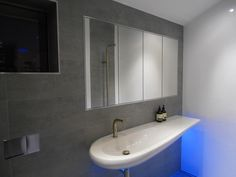 Bathroom Renovation Perth - Amazing Alessi sink, and creative use of under lighting.