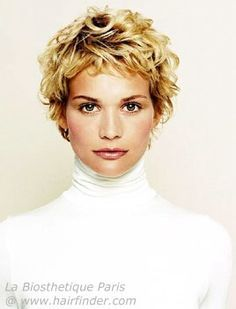 short curly hair and a white turtleneck